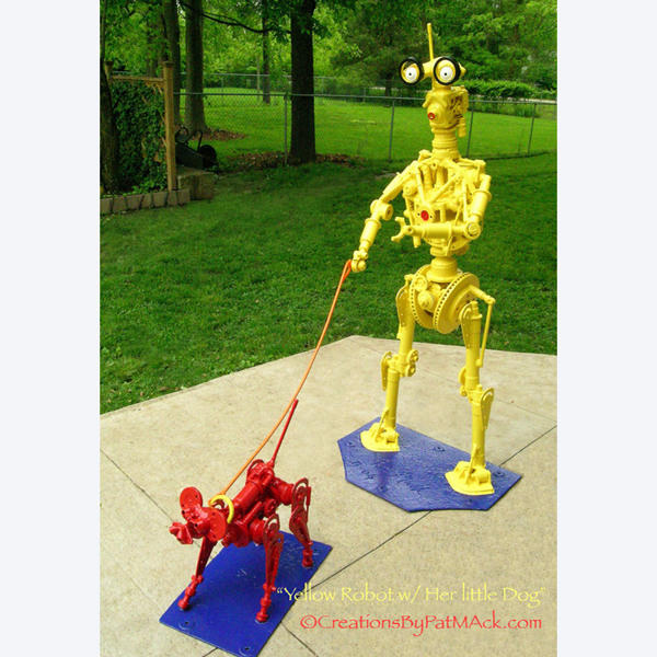 """""""Yellow Robot Walking Her Little Red Dog"""" post image"""